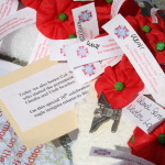 Close up of poppies on the Veterans Wreath.