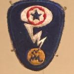 The official patch for uniforms of the Manhattan Project (photo by the author from the special exhibit, Manufacturing Victory)