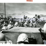 D-Day on Iwo Jima with the 4th Infantry. February 19, 1945. U.S. Navy, Gift of Charles Ives, from the collection of The National WWII Museum. 2011.102.559.