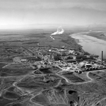 Hanford was built on the banks of the Columbia River in central Washington. Having spent a summer catching lizards and snakes there, I can tell you it's still far from anything but cherry and apple orchards.