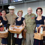 Blakey with fellow WWII veteran Bert Stolier and the Museum's Victory Belles on Veterans Day in 2013.