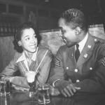 Sgt. Franklin William, home on leave from army duty, with his best girl Ellen Hardin, splitting a soda. May 1942.