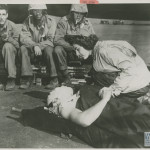 Navy nurse Jane Kendiegh tends to a wounded soldier on a ship off of Iwo Jima, 1945. Gift of Charles Ives, from the collection of The National WWII Museum. 2011.102.548.