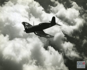 Vought Corsair skimming clouds at 400 miles per hour. Official U.S. Navy Photograph, Gift of Mary Noble, from the collection of The National WWII Museum.