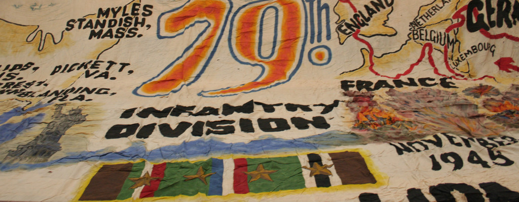Detail of Destination Home and Peace Mural (banner) painted in Germany by Cpl. Norman E. Linn of the 79th Division. Gift of the 314th Infantry Association WWII. 1999.115.001.