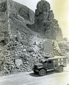 An ambulance moves past a destroyed German fortress at Terracina, Italy on 26 May 1944.