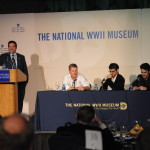 Hugh Ambrose moderates a panel with 'Band of Brothers' stars Michael Cudlitz (L) and Ron Livingston (R), and screenwriter John Orloff (C) in 2008.