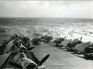 Grumman Avengers aboard an aircraft carrier during heavy seas