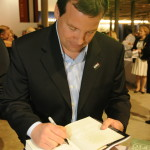 Hugh Ambrose signs a copy of his bestselling book at the 2010 screening of 'The Pacific' at the Museum.