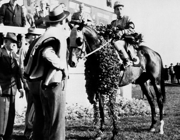 Count Fleet, with jockey Johnny Longden wearing the wreath of roses after winning the 69th running of the Kentucky Derby, May 1, 1943. From the Associated Press.