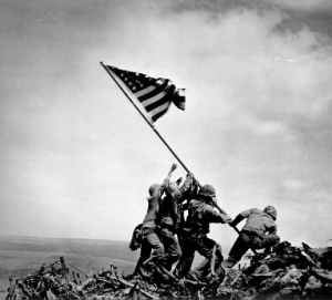 Flag-raising on Mount Suribachi, Iwo Jima on February 23, 1945. Courtesy of The National Archives and Records Administration.