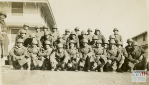 A large group of soldiers in winter coats and helmets pose for a photograph outside barracks at Camp Carson, Colorado. May 1944 Price:  select a license to see price. Part of the Museum's digital collection.