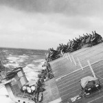 The fleet's ships, like the USS Cowpens shown here, rolled and pitched, causing them to take on water, and for planes aboard to be lost or damaged.