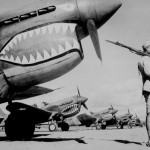 A Chinese soldier guards a P-40 painted with the Flying Tigers' famous shark face. National Archives and Records Administration.