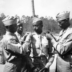 Thousands of African American Army officers were commissioned during the war, including these newly-minted second lieutenants at Fort Benning, Georgia, in May 1942. National Archives, 111-SC-137679.