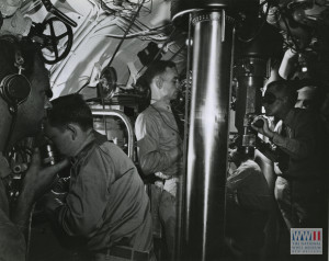 Torpedo Attack - A commanding officer at the periscope of a U.S. submarine, ready to loose torpedoes on the enemy.