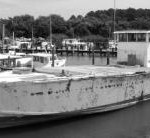 In 1988, after 41 years as a tour boat, scalloping boat, and fishing boat, PT-305 was sold again, this time to two oyster fishermen, who used the boat to seed oyster spat in the Chesapeake Bay. Notice here that 13 feet in length was removed from the stern .