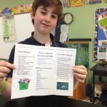 A Chesapeake Academy student showing off his recycling brochure.