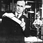 This is Wallace Carothers posing for a company photo in his DuPont lab. From WikiMedia Commons.