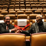 Bert sitting with fellow WWII veteran volunteer Forrest Villarubbia in the Solomon Victory Theater. In the theater, they both had seats dedicated in their honor.