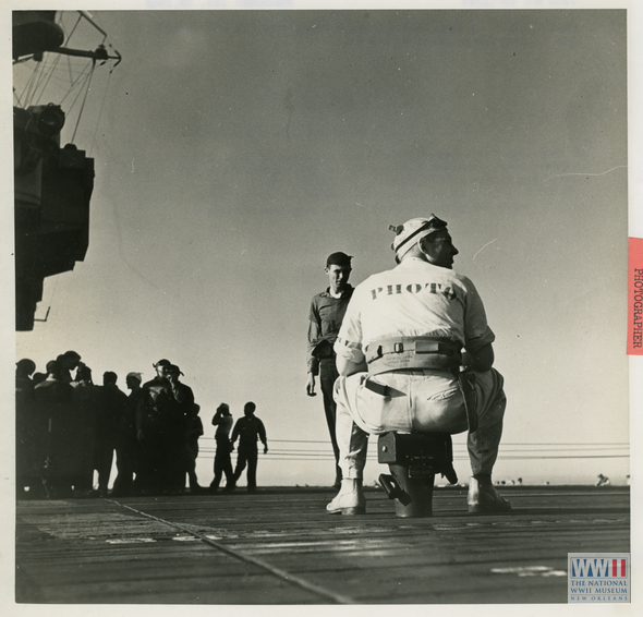 A Navy Photographer on an aircraft carrier deck in January 1945.