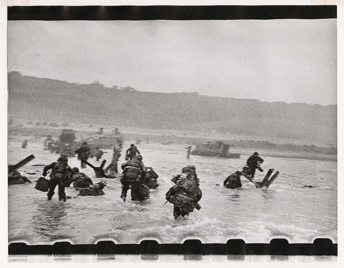American soldiers landing on Omaha Beach, D-Day, Normandy, France. Photo courtesy of International Center of Photography