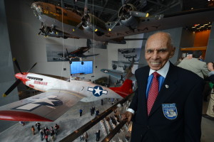 Roscoe Brown with the P-51 Mustang replica painted in the likeness of the plane he flew during the war. Today a restored P-51 Mustang hangs there as a tribute to his service.