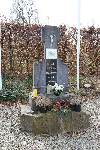 The US Wereth Memorial in Wereth, Belgium. Belgian civilian Hermann Langer was only 11 years old when he met and helped shelter the 11 men of the 33rd Field Artillery Battalion before their capture and murder. In 2004, Langer established a nonprofit and erected this monument remembering them.  In May 2015, Museum staff and volunteers traveled to the memorial to pay their respects to the Wereth 11.