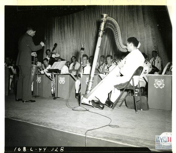 RUDY VALLEE CONDUCTING THE UNITED STATES COAST GUARD BAND WHILE ENTERTAINING TROOPS IN CALIFORNIA ON 30 JANUARY 1944