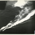 A U-boat as it is hit by a torpedo.