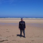 Dr. Harold Baumgarten at Omaha Beach with a Museum tour in 2006.