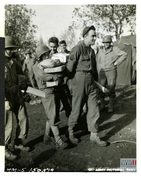US soldiers receive Christmas mail in Italy on November 1943.