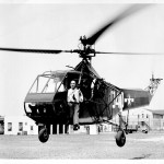 That is Sikorsky, sitting in the doorway of one of his YR-4 helicopters.
