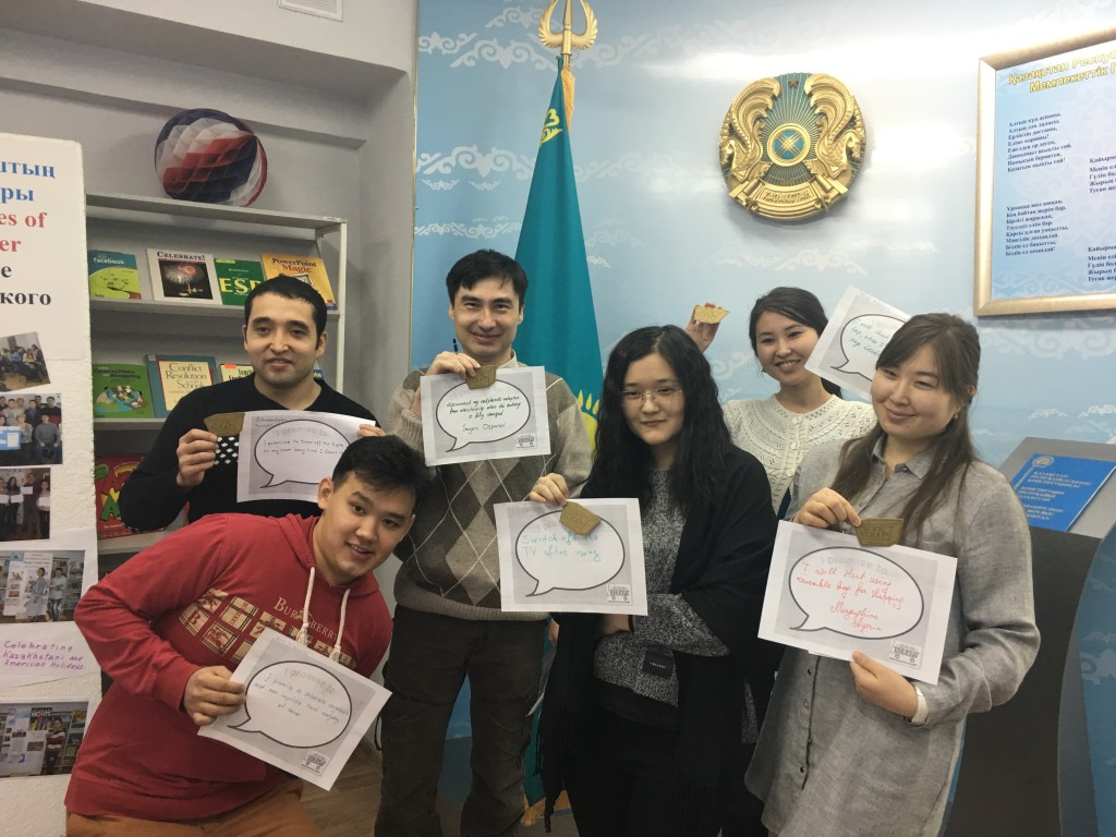 The American Corner Karaganda group with their 25 point prize — a Get in the Scrap! refrigerator magnet. Students also proudly display their Quote Promise Pix.