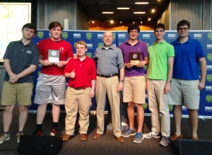 Quiz Bowl finalists: Tyler McStravick, Nate Belcher, and Nicholas Kurzy of St. Thomas High School; quizmaster and Museum Director of Education Kenneth Hoffman; Matthew Granier, Ethan Lagrand, and Preston Warwick of Jesuit High School.
