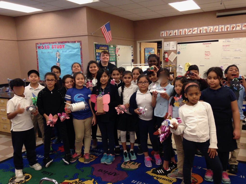 The Dolphins from Sovereign Avenue School in New Jersey show of their water bottle piggy banks.