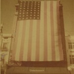 Godchaux's on Canal Street with US flag flown during the war, c.1945